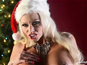 Holiday taunt and finger masturbation from Nikita