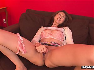 asian mummy has a intercourse plaything session with her vag