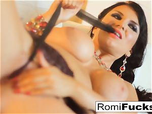 Smoking hottie Romi Rain takes care of her humid cooch