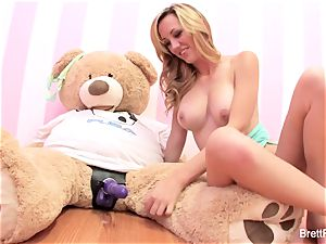 Brett Rossi plays with a plunged bear's strap-on faux-cock