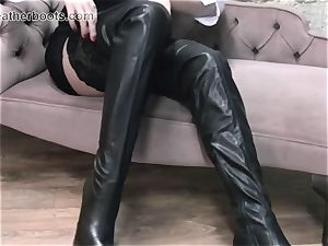 wondrous secretary leisurely pulls on her leather thigh shoes