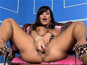 handsome Lisa Ann tucks her fake penis deep in her moist vulva