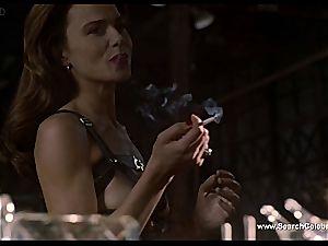 black-haired Lena Olin in underwear demonstrates off her smallish mammories
