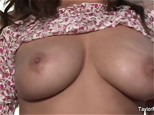 dark-haired beauty Taylor plays with her gigantic boobies