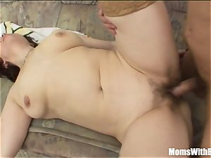 ginger-haired Stepmom In stocking older sofa hook-up