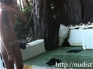 Spy web cam shot of a super-hot naturist honey tanning on the beach