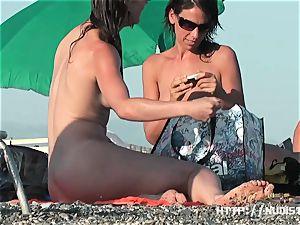 A thrilling bare beach voyeur spy webcam video